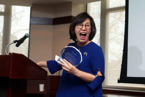 Su-Je Cho standing a a podium