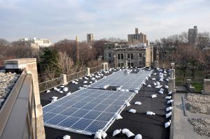 solar panels being installed on the roof of the Walsh Library in 2009