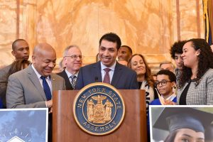 Yohan Garcia speaking from a podium at the state capitol in Albany
