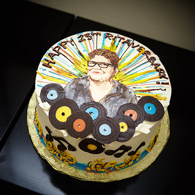 Round cake with RIta Houston's image for her 25th anniversary