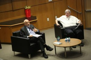 Joseph Stiglitz and Bruce Greenwald sitting on stage at the McNally Amphitheatre