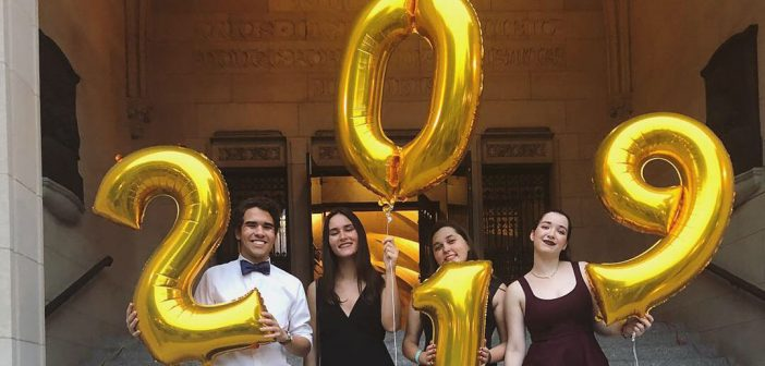 students holding balloons that say 2019