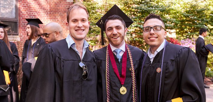 Three men in academic robes, with one wearing a medal.