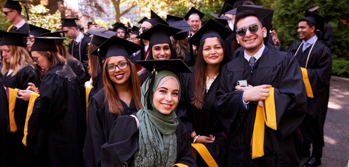 Group of graduates wearing black academic robes