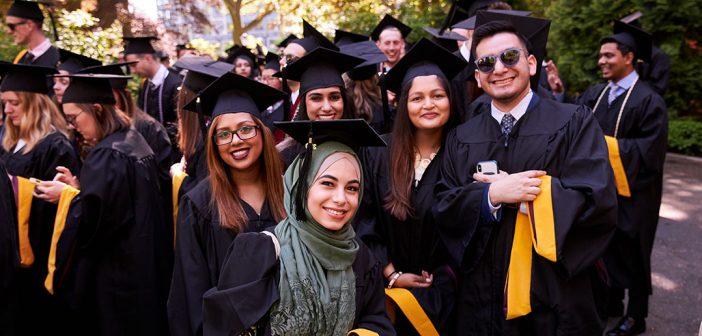 Group of graduates wearing black academic robes