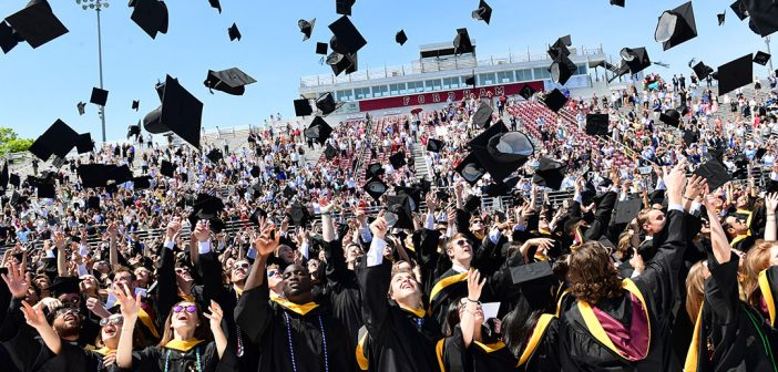 Hat toss at the Gabelli School diploma ceremony