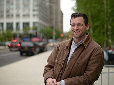 Law graduate Tyler Crawford in brown jacket