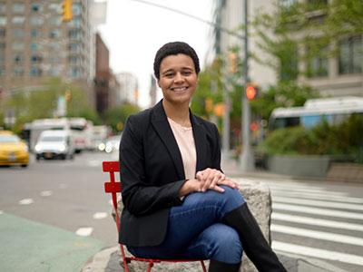 Gabelli graduate Erica Harell sitting outside in Manhattan