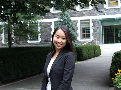 Fordham College at Rose Hill graduate Lala Kumakura in a blazer on the Rose Hill campus