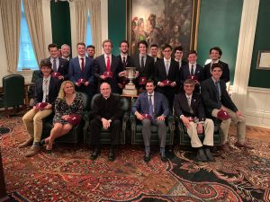 The crew team seated with Father McShane