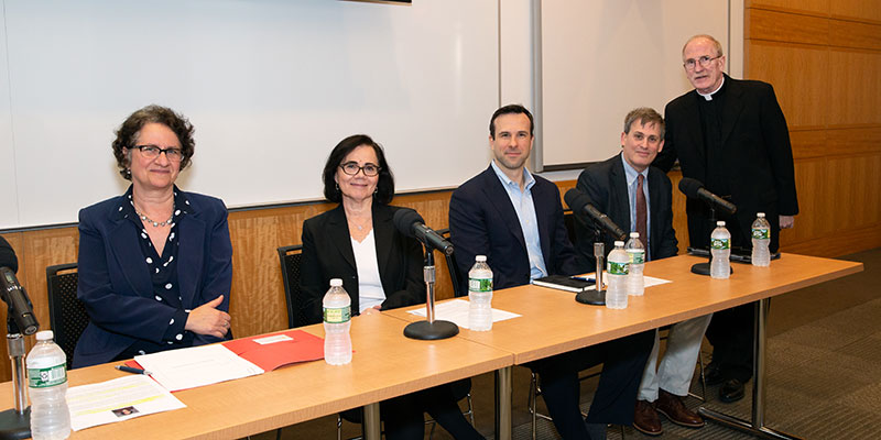 Panelists with Joseph M. McShane, S.J., president of Fordham