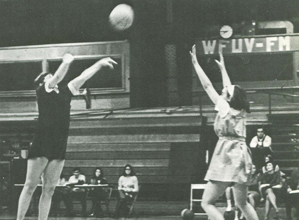 Barbara Hartnett Hall shoots over a defender during a basketball game.