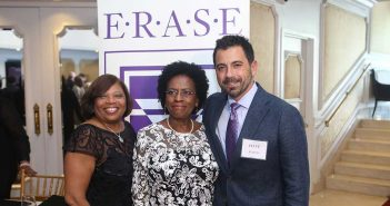 Gross and Lewis receive awards from ERASE Racism's president.