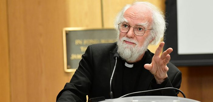 Rowan Williams gestures from the podium
