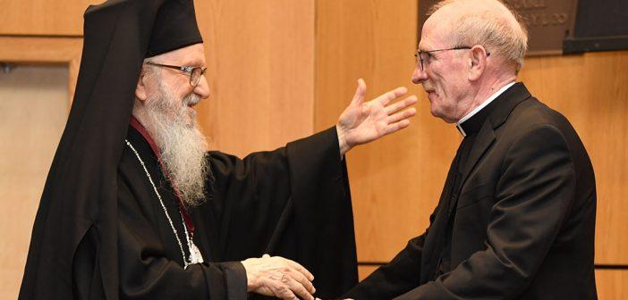 Joseph M. McShane and Archbishop Demetrios exchange hugs