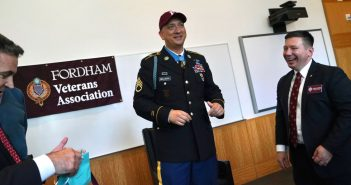 A man wearing a military uniform and a Fordham baseball cap