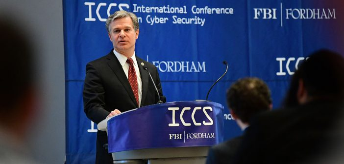 FBI director Chris Wray speaks at a podium