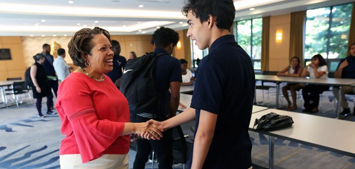 Trustee Valerie Rainford and high schoolers at Rose Hill