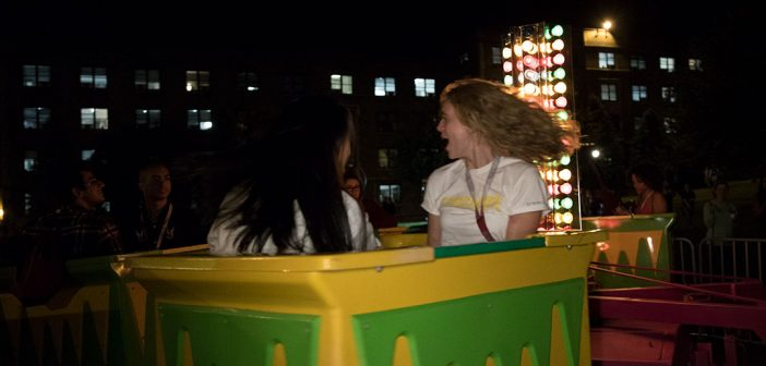 Two women on a carnival ride at Rose Hill, Opening Day 2019