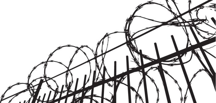 Line drawing of fence topped by razor wire