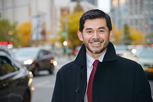Fordham theology professor Leo Guardado pictured on the street near Fordham University's Lincoln Center campus
