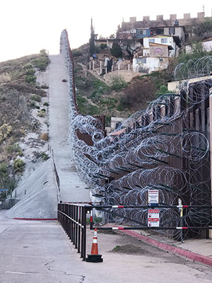 A view of razor-wire coil fencing from the Nogales, Arizona, side of the U.S.-Mexico border