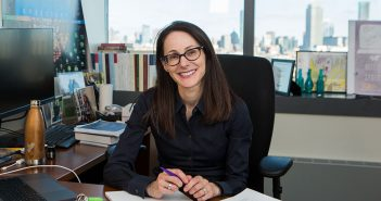 "Fordham Law alumna Danielle Citron, a 2019 recipient of a MacArthur Foundation ""genius"" grant, sits at her desk at Boston University, where she is a professor of law."