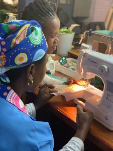Women work at a sewing machine
