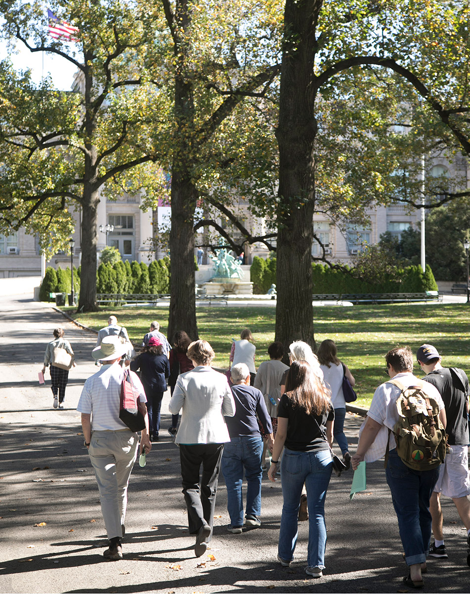 A student and alumni tour group at the New York Botanical Garden