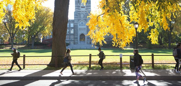 Students walking at Rose Hill with Keating in the background