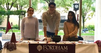 students at a table in FCLC lobby