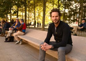 John Seitz sitting on a bench