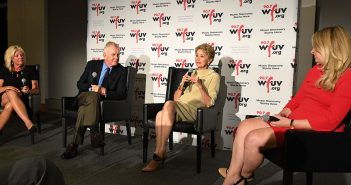 Christine Driessen, Tim McCarver, Jane Pauley and Sarah Kugal, seated in front of a WFUV step and repeat banner