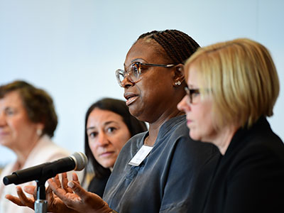 Valerie White speaking on a panel