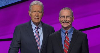 Host of Jeopardy Alex Trebek poses with Ed Condon, FCRH'84.