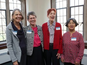 Four women standing together