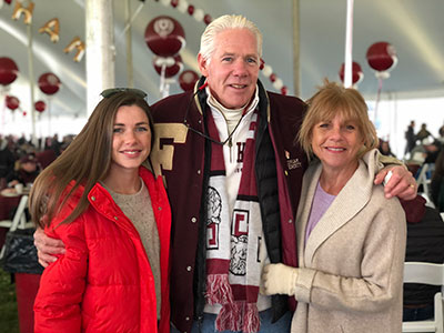 Healy family- husband, wife, and daughter, at Rose Hill for Homecoming
