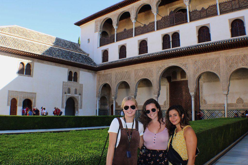 women standing in front of a villa in Granada