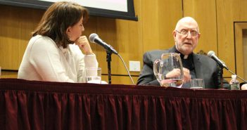 Two panelists talk at lecture