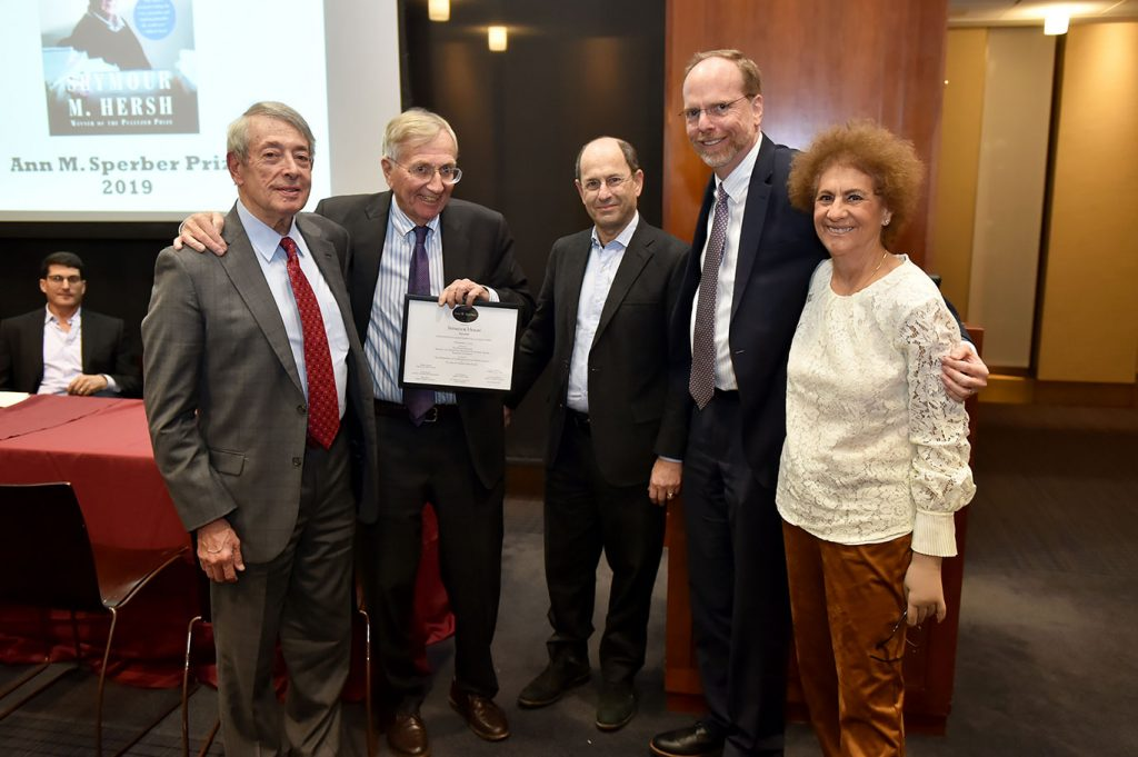 Seymour Hersh poses for a picture with the Sperber family and members of the Fordham faculty.