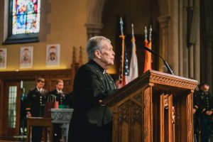 Father Sullivan at pulpit