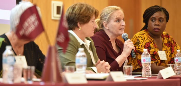 Women speak on a panel for student athletes.