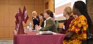 Women participate in a panel