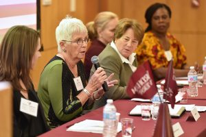 Panelists talk at a forum for female athletes.