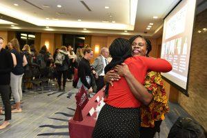 Professor Shannon Waite hugs a participant.