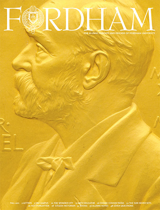 Image of the cover of the fall 2011 issue of Fordham magazine featuring a detail of the Nobel Prize medal