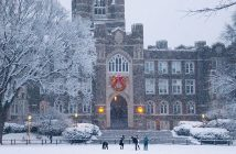 Students playing in the snow in front of Keating Hall at Rose Hill