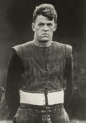 John Szymanski standing on the field