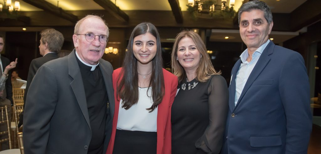 Fr. McShane with Founder's Scholar Kristen Harb and her parents Rula and Simon Harb