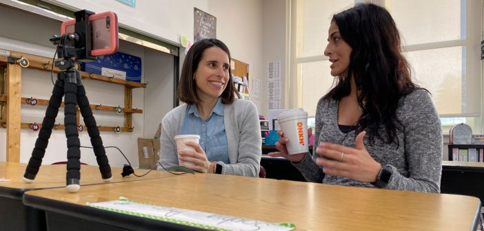 Two teachers talk for a video series